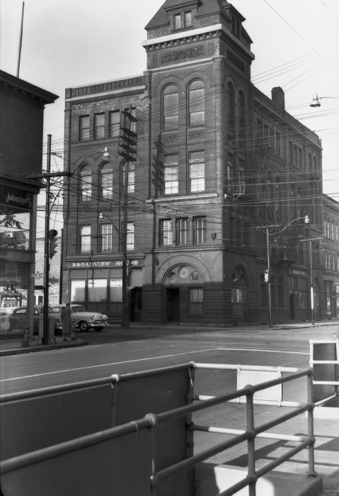 Corner of Queen & Broadview, Toronto, Canada. The stairs leading down, in the left front of photo, was one of Toronto's last public toilets. I purchased my bedroom furniture in 1969 from Johnston's on the left side.