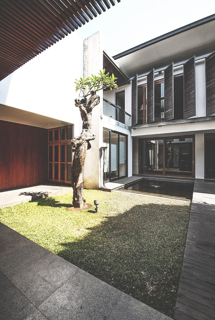 Sister House Image 19. Project : 2628 Sister House Location : Bandung, Indonesia Site Area : 597 m2 Building Area : 600 m2 Design Phase : 2011 Constrution Phase : 2011 - 2013 Description : 2 houses being designed as one building with 2 families live there.  #architect #bandung #jakarta #architectindonesia #archdaily