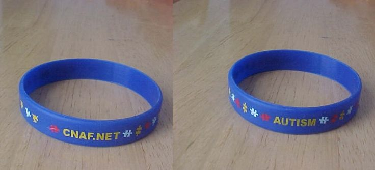 Autism rubber bracelet (has multi coloured puzzle pieces around it AUTISM printed on one side & cnaf.net on the other side)