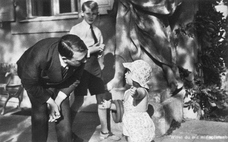 Helga Goebbels with Adolf Hitler. Harald Quandt in the background. Obersalzberg, 1936.