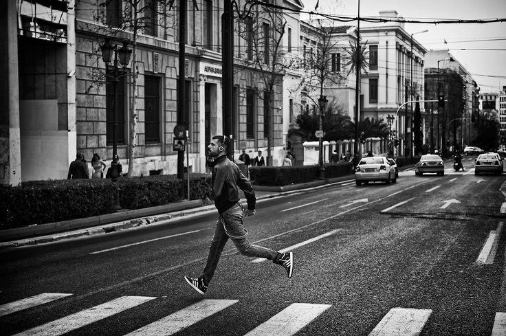 Running man Last week I was in Athens on Business, that is the reason why I hadn't posted anything for a few days. My business partner was driving his bike down Panepistimiou Avenue, one of the most known Avenues in the centre of Athens. I had my NEX-6 strapped to my neck and was shooting as much as I could. Suddenly this guy, crossed the street while we were moving and he barely got to the other side without having an accident. I snapped him in flight!