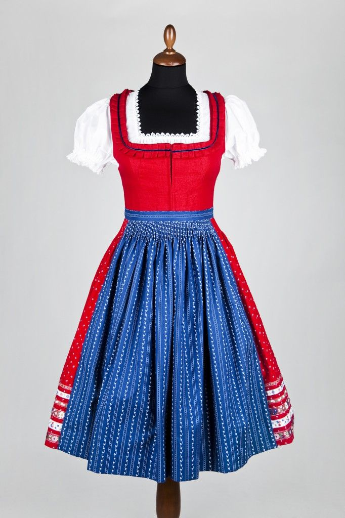 dirndl - for days when I am feeling more than a little Germanic. -- Love the skirt with ribbons on it and that it has printed fabrics! and the detail at the neckline.