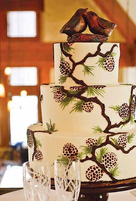 Brides Pine Cone Wedding Cake With Bird Topper