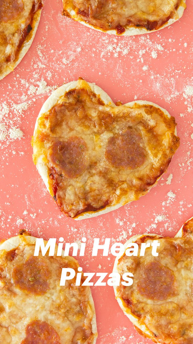 Homemade mini heart pizzas are so easy to make! Perfect for valentines, pizza lovers, or occasion! (Click through for recipe video) by Sarah Hearts Valentines Day Dinner, Valentines Food, Valentine Treats, Valentine Heart, Heart Shaped Pizza, Heart Shaped Cookie Cutter, Wraps, Mini Heart, Kid Friendly Meals