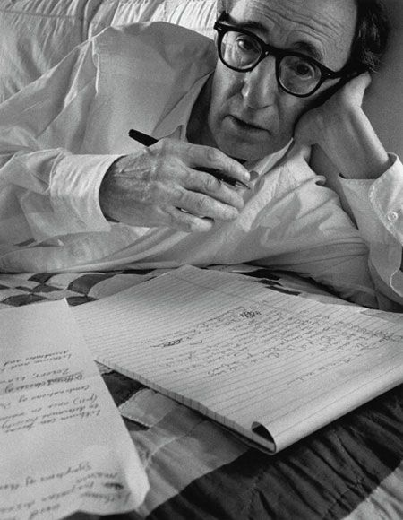 Woody Allen writing in bed, 1996. Photo credit: Arnold Newman.