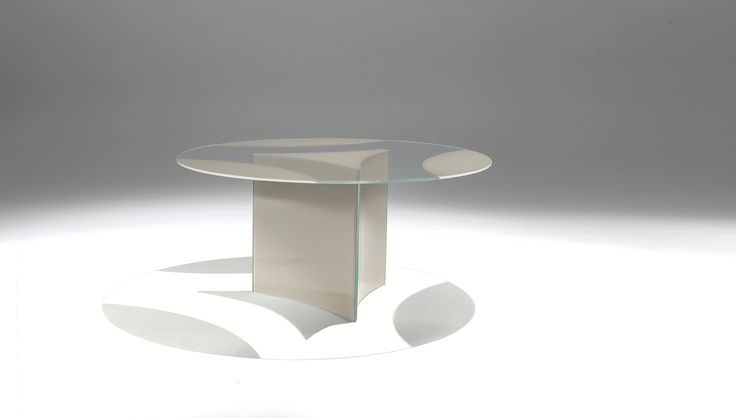 Casali :: Dioniso Table with circular top made of 12 mm extra-clear tempered glass, with partly lacquered back. Supported by three 10 mm extra-clear tempered glass curved panels with lacquered back. Opaque lacquers.   Available colors White, Black, New Colors   Weight 109 kg