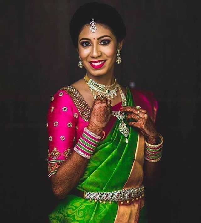South Indian bride. Gold Indian bridal jewelry.Temple jewelry. Jhumkis. Green silk kanchipuram sari with contrast pink blouse.Braid with fresh jasmine flowers. Tamil bride. Telugu bride. Kannada bride. Hindu bride. Malayalee bride.Kerala bride.South Indian wedding.