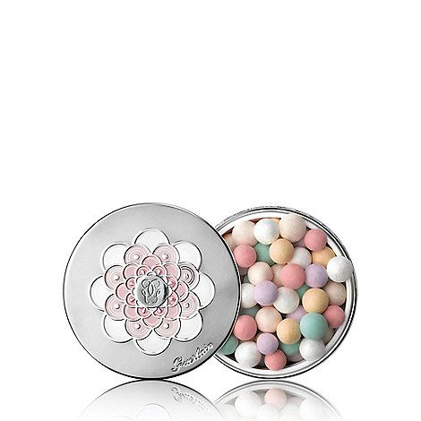 In 1987, Guerlain harnessed loose powder into a constellation of multicoloured pearls that reveal the secret of absolute radiance for every complexion. With an ethereal texture and inimitable violet fragrance, Météorites illuminate women's beauty and have won cult status. Today, Météorites hold the secret to Stardust technology, a light-creating polymer, which transforms light invisible to the naked eye into a pure and endless glow on the skin. The signature corrective shades of Météorit...