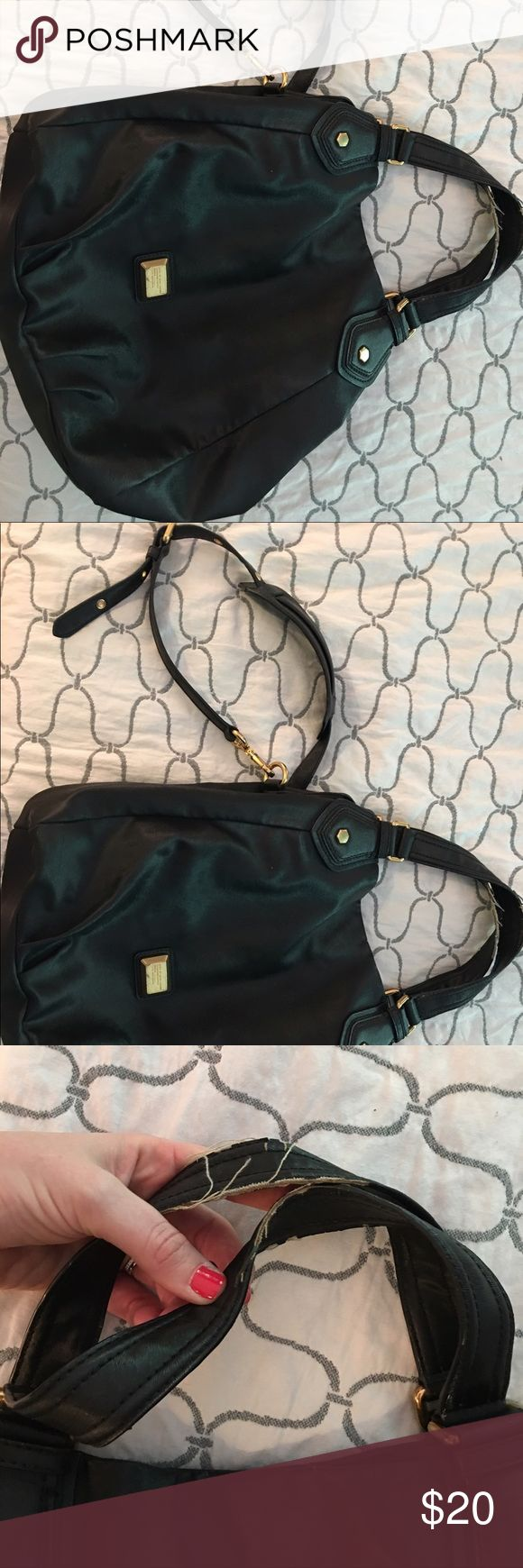 Used Marc by Marc jacobs handbag! Marc by Marc Jacobs handbag for sale! $20 Definitely has some wear on the shoulder strap and the Marc by Marc emblem on the front but other than that, simply gorgeous bag!!! Marc by Marc Jacobs Bags Shoulder Bags