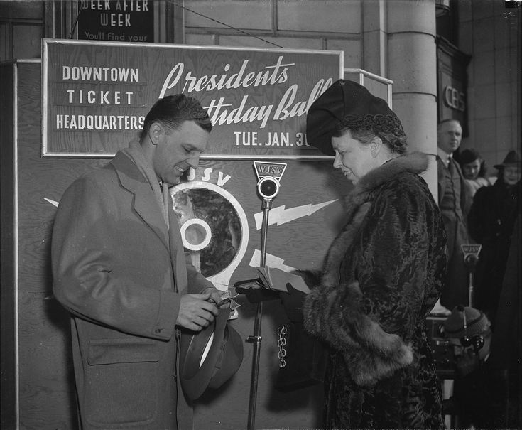 1940.Eleanor Roosevelt buying the first ticket to the 1940 President's Birthday Ball to fight infantile paralysis, MRS. ROOSEVELT BUYS FIRST TICKET TO PRESIDENT'S BIRTHDAY BALL. WASHINGTON, D.C. JANUARY 16. LAUNCHING A DRIVE FOR THE SALE OF TICKETS TO THE PRESIDENT'S BIRTHDAY BALL SCHEDULED FOR JAN. 30, MRS. ROOSEVELT TODAY BOUGHT TICKET NO. 1 FROM WJSV ANNOUNCER A.D.-JESS- WILLARD AND MADE A SHORT BROADCAST APPEALING FOR SUPPORT OF THE FUNCTION, FUNDS FROM WHICH WILL GO TO RELIEVE SUFFERING…