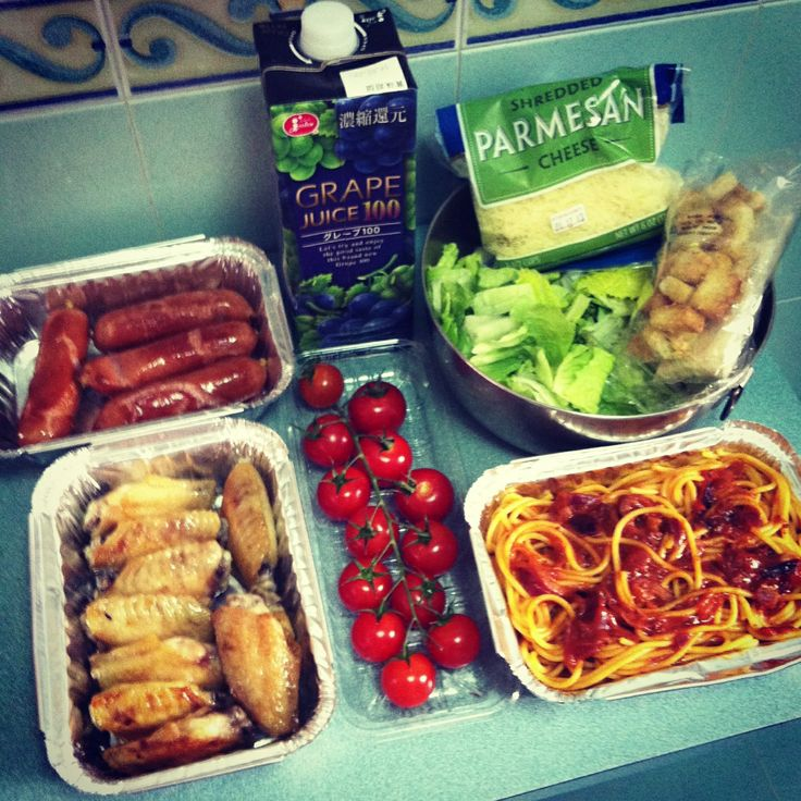 Yummy foods for picnic day, Honey chicken, Garlic sausage, Fresh tomato, Caesar salad, Red onion tomato spaghetti, Grape juice