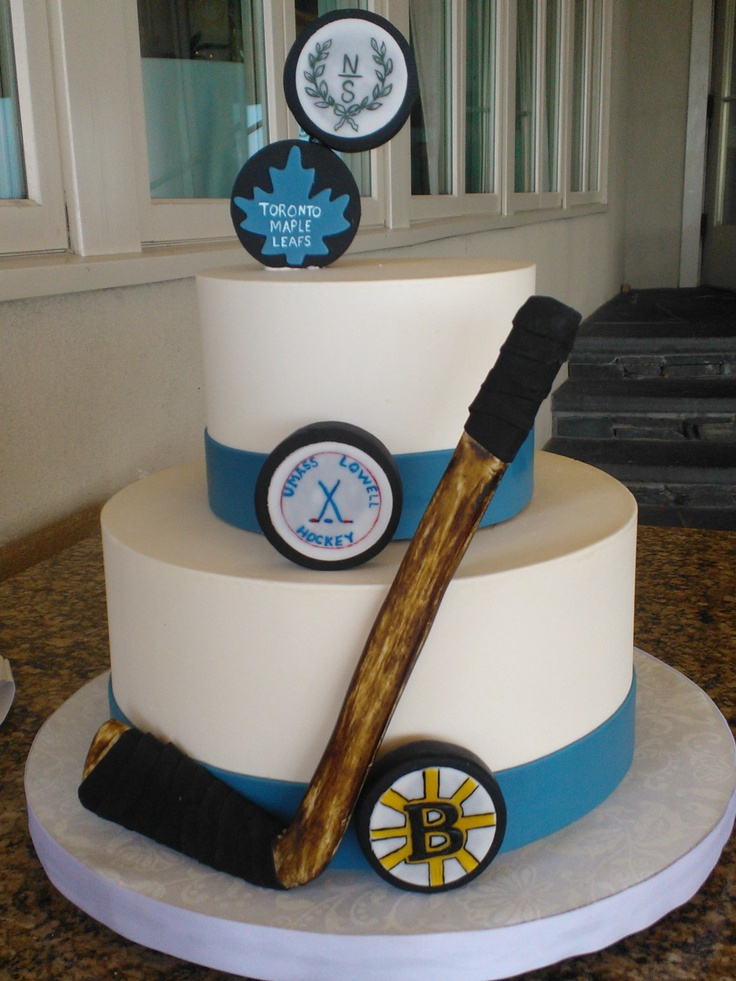 Ice-hockey theme... change the white to blue and the blue to orange and add Oilers pucks and we have a cake!
