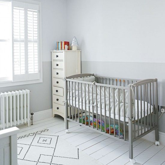 Instead of the usual blue or pink colour scheme for a nursery, why not choose delicate shades of grey? White wooden shutters continue the minimal look while a tall chest of drawers provides plenty of storage in this clutter-free space. The cot has been given a coat of contemporary grey, which still looks calm and restful.