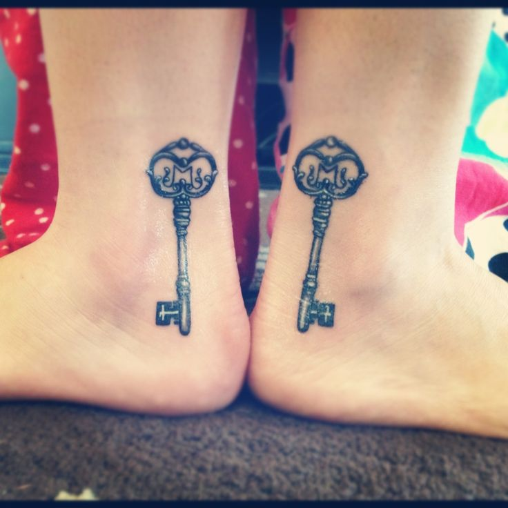 Matching sister tattoos.