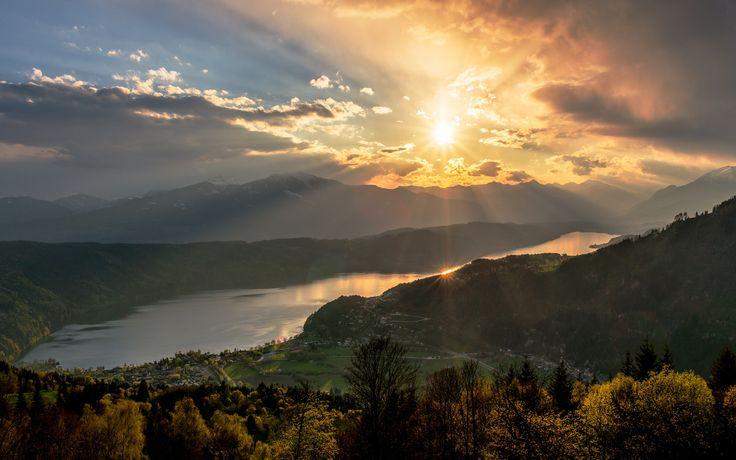 Sun over lake Millstätter See in Carinthia, Austria.