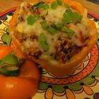 Quinoa Stuffed Peppers - Bell peppers are stuffed and baked with quinoa, vegetables, and tomato sauce. Top with bubbling mozzarella cheese for a hearty and flavorful meal.