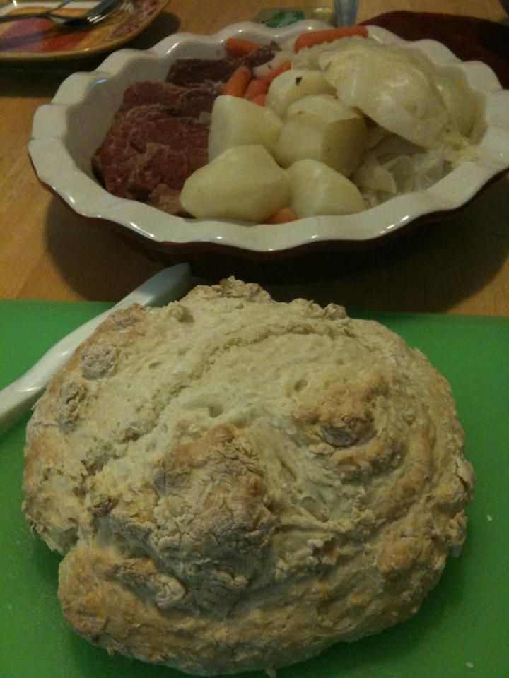 Corned beef with potatoes, carrots and cabbage for St. Patrick's Day. It wouldn't be complete without a big, round loaf of soda bread!