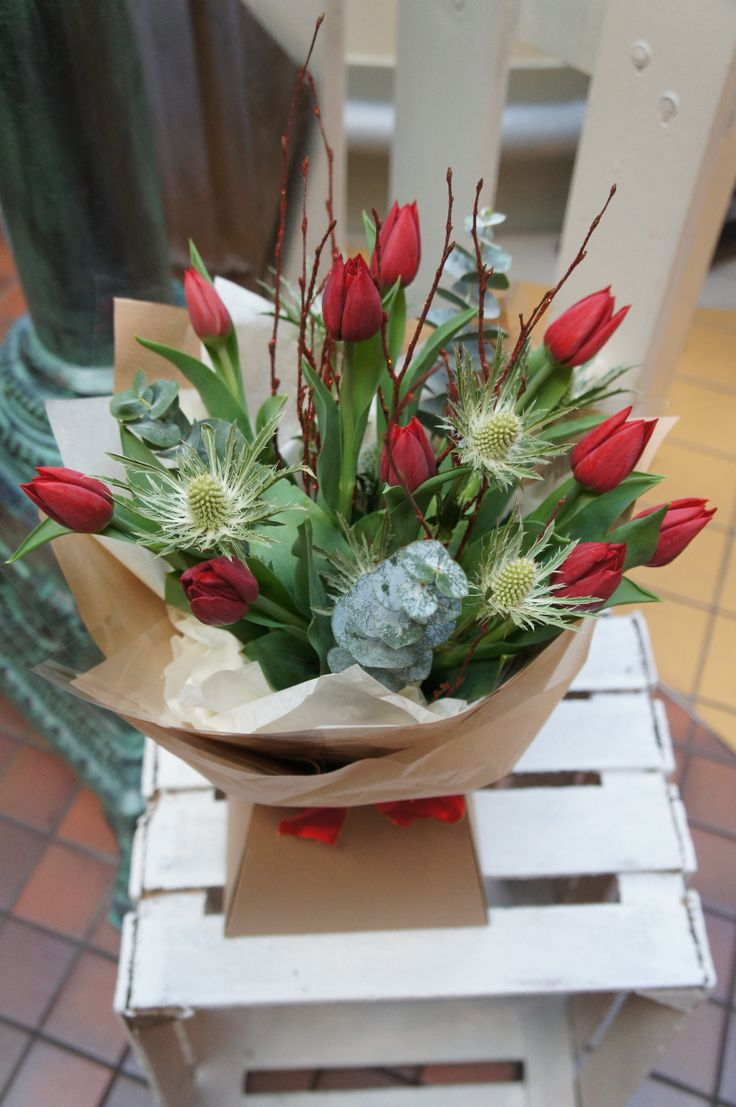 tempting tulips with frosty thistles