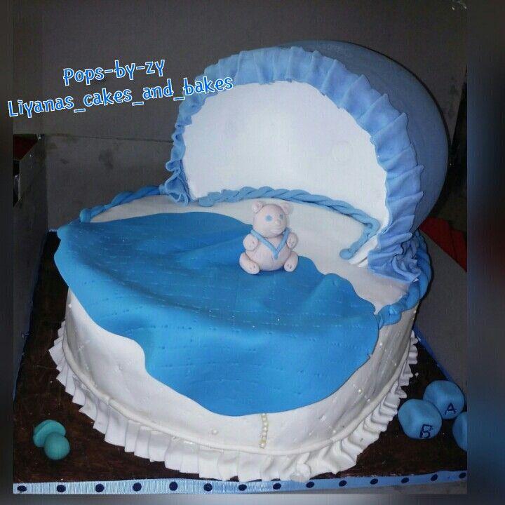 Fondant covered bassinet cake