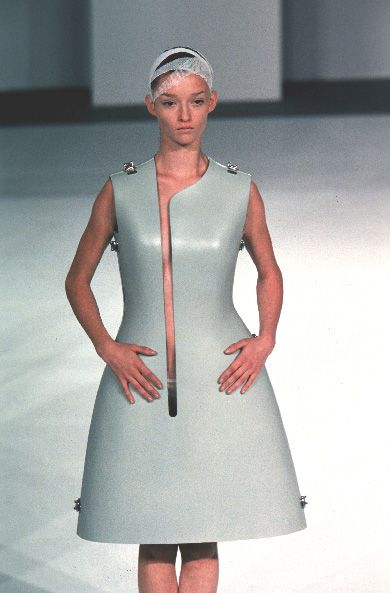 """Hussein Chalayan SS '99: """"Named British Designer of the Year twice (in 1999 & 2000) & awarded an MBE for contributions to fashion in 2006, Chalayan became well-known for taking his inspirations from ideas that are not usually associated with fashion, such as exile, alienation, power & powerlessness, nomadism, cultural displacement, transformation, individuality."""" [Pin by Heidi Tunberg]"""