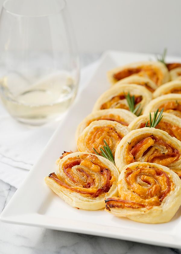 Ham cheddar and rosemary pinwheels recipe - uses puff pastry. I will omit honey and rosemary and flavor to my taste.