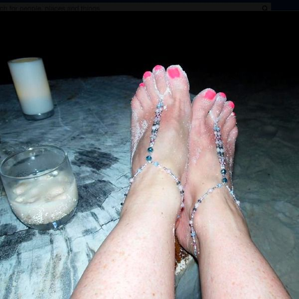 Barefoot Slinking it up in the Maldives - toes covered in sand!