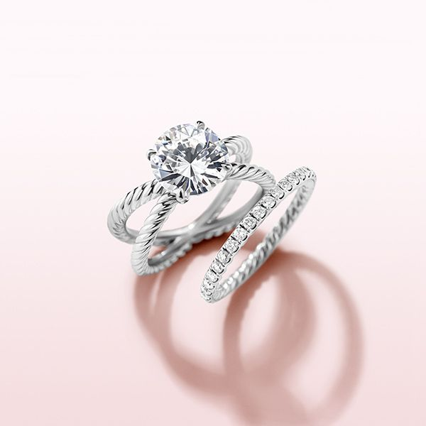 Two strands of Cable present a brilliant diamond in the DY Crossover® engagement ring. It's the ultimate symbol of love and unity.