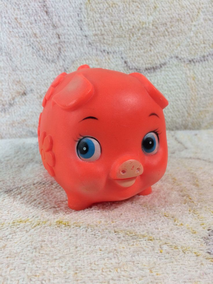 1980s Neon Hard Plastic Piggy Bank Orange Red Cute Bug Eyes Rubber by TheOddOwl on Etsy https://www.etsy.com/listing/488273330/1980s-neon-hard-plastic-piggy-bank