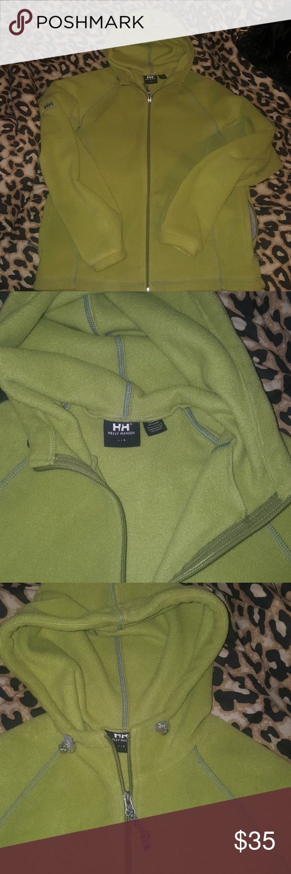 Helly Hansen Fleece Jacket Ladiea size large. Excellent condition. Worn once. Olive green with grey trim stitching. Fleece is excellent for cold weather. Its heavy and thick material compared to other fleece jackets. I love it but its the wrong size for me. Nothing is wrong with the jacket at all. Thanks for stopping by! Helly Hansen Tops Sweatshirts & Hoodies