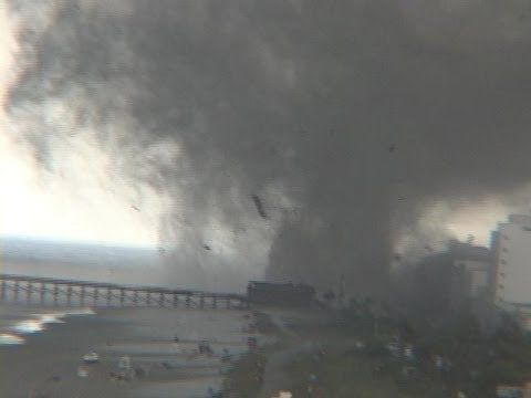 MYRTLE BEACH, South Carolina, July 6, 2001, (VIDEO ONE), F1 and F2 tornadoes. Two unusual visitors disrupted the carefree routine of beach-goers in the late afternoon at this popular ocean resort town. This first video shows both the short-lived first EF1 that hit the north side of the beach and the other, stronger and more damaging and well-defined cone tornado to the south. Only minor injuries resulted. (Kevin@RKy)