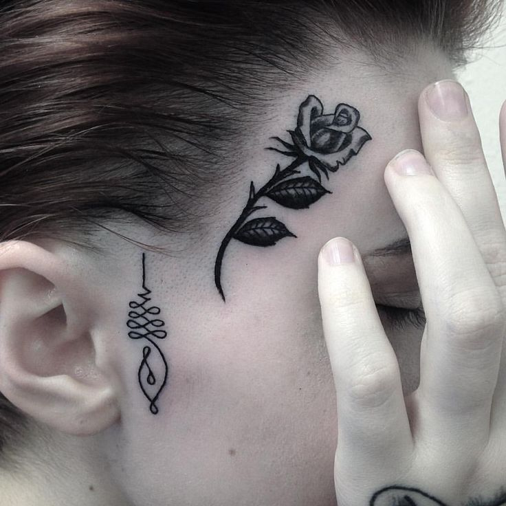 Gorgeous Rose tattoo. Click on image for more face tattoos that are surprisingly awesome.