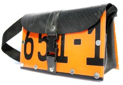 Handmade from recycled car number plates in South Africa. http://www.thefairtradestore.co.uk/fair-trade-bags/recycled-car-number-plates-handbag-orange/prod_488.html