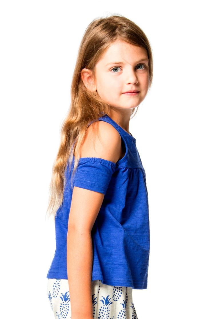 In a bright blue hue that's perfect for spring and summer, the Cold Press Fashion Open-Shoulder Cotton Top is easy to pair with any of our printed pants or leggings. This short sleeve crop top features cut out cold shoulders, a shirred front yoke, a scoop neckline, and a button back with a small keyhole. Shop now at deuxpardeux.com #kidsstyle #dress #littlegirl #kidsfashion #littleboy #kidswear Follow our Pinterest page at @deuxpardeuxKIDS