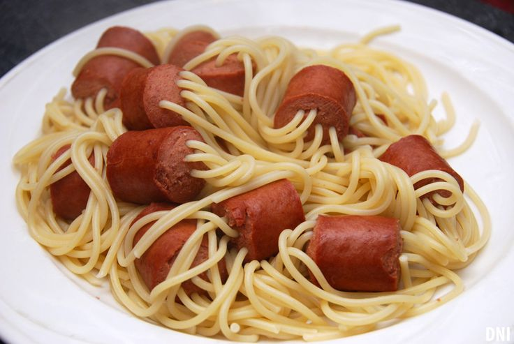 Thread uncooked spaghetti through chunks of hot dog. Boil until noodles are cooked. Works with any long, firm pasta.