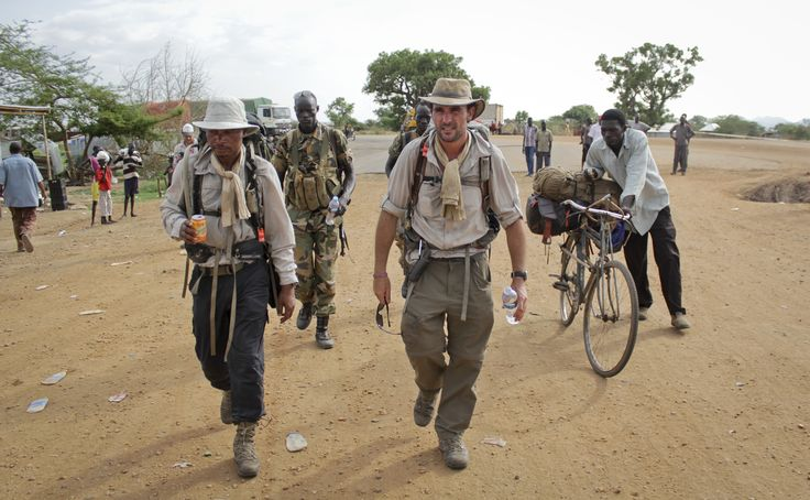 Former British Army captain Levison Wood, center, sets out walking along the Nile river from Juba, in South Sudan. -AP Photo