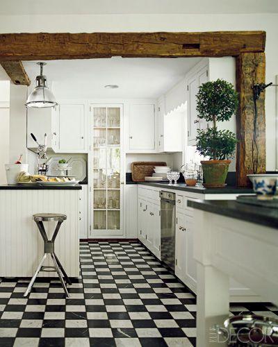 Wooden beam and checkered floor. Via #ElleDecor