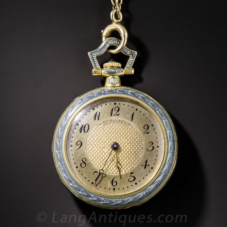 By the renowned Swiss watchmaker, Longines, circa 1910-20, a superb and stunning pendant watch and matching chain crafted in 18K yellow gold and shimmering with steely-blue guilloche enamel overlaid with platinum and diamonds. The lovely matching chain measures 25 inches long. One very tiny flaw in the enamel at 2 o'clock.