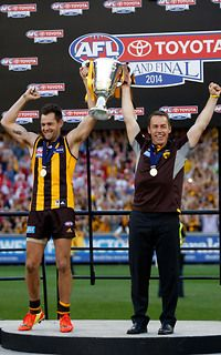 Captain Luke Hodge and coach Alastair Clarkson of the Hawks hold up the Premiership Cup after the 2014 Grand Final.