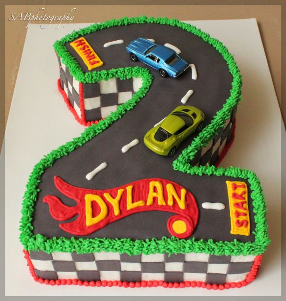 2HotWheels1 Great boys cake. Hot wheels cake / racing car cake. If you are making this yourself most good cake suppliers will lone a number shaped cake tin for a fraction of the cost of buying one.