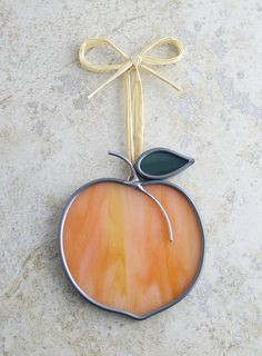 peach stained glass ornament.