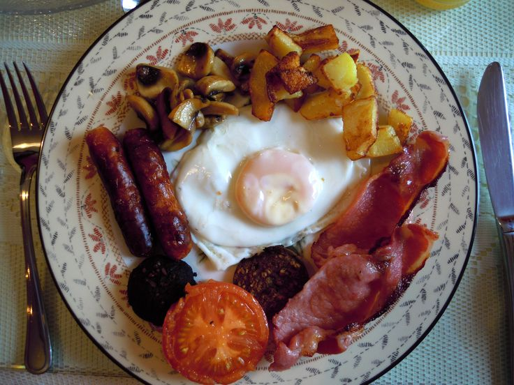 Full Irish Breakfast: bangers, ham, sausage, mushrooms, potatoes, tomatoes, black pudding, toast, and an egg.   Just need a coffee and life is perfect.