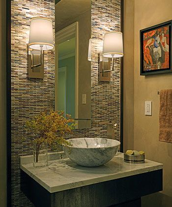 The textures from the various materials used in this powder room makes this room so visually pleasing. | Leslie Fine Interiors
