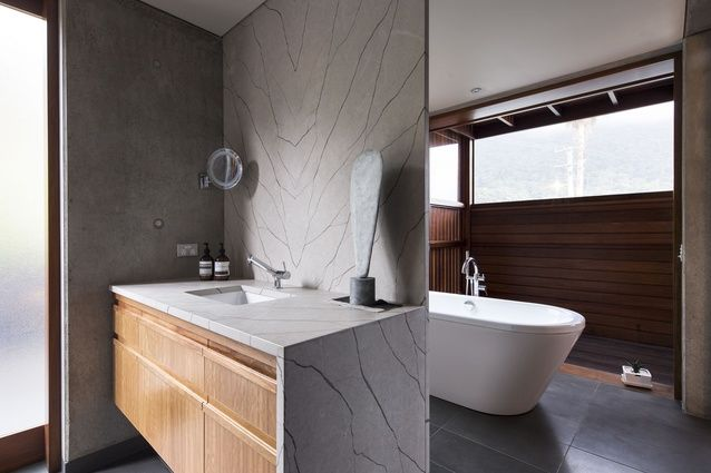 South Coast House NSW. The Northern bathroom wall slides away to give access to a private screened balcony.