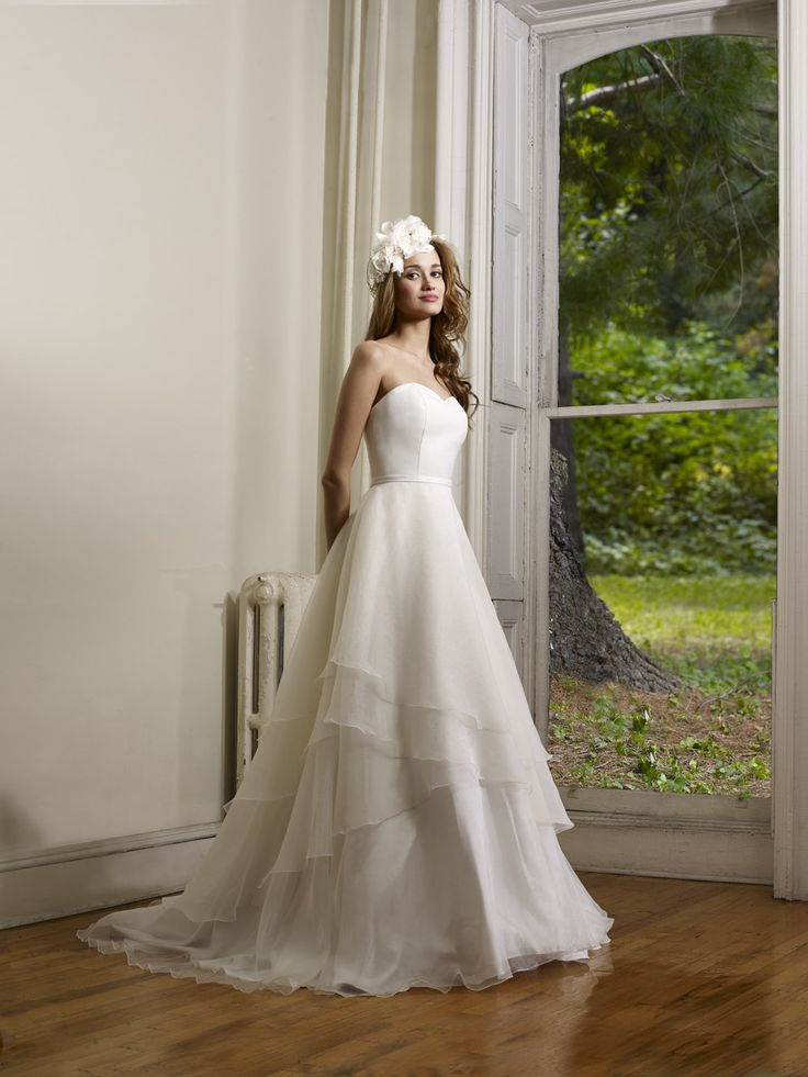 Strapless organza multi layer ball gown with matte satin waistband.