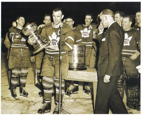 Leaf captain Teeder Kennedy cradles half a Stanley Cup in 1949