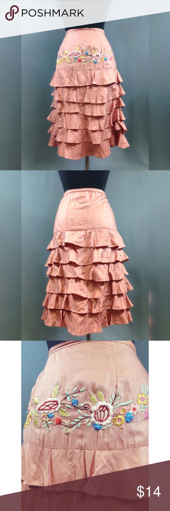 """Pink tiered flounce skirt Are you a boho flower child who works a cubicle?  A free spirit but need to follow professional dress codes?  I got a skirt for you.  This knee-length skirt is a gorgeous light coral color with an embroidered front panel and tiers of ruffles.  Side zip.  Flaws: tiny pinhole near side zip Brand: Papillon   Size: L (measures as size 12, marked as such)  MEASUREMENTS: (flat, inside out) Length: 26.5 waist to hem Waist: 32"""" Hips: 40"""" Skirts Midi"""