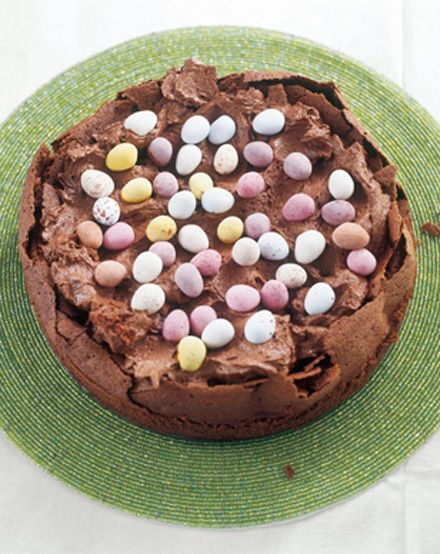 There are not many recipes I absolutely have to make, year in, year out, at Easter, but my Easter Egg Nest Cake, is absolutely non-negotiable. Think damp, dark, flourless fallen chocolate cake (incidentally, gluten-free) with the dip filled, once the cake has cooled, with whipped cream that has had melted chocolate folded into it, and then dotted with those sweet little pastel-toned, sugar-coated easter eggs. Just thinking about it lifts my heart.
