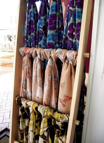 I just really need to do this: display scarves on a ladder for easy pickings!
