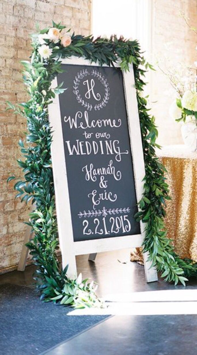 Garland around chalkboard signs