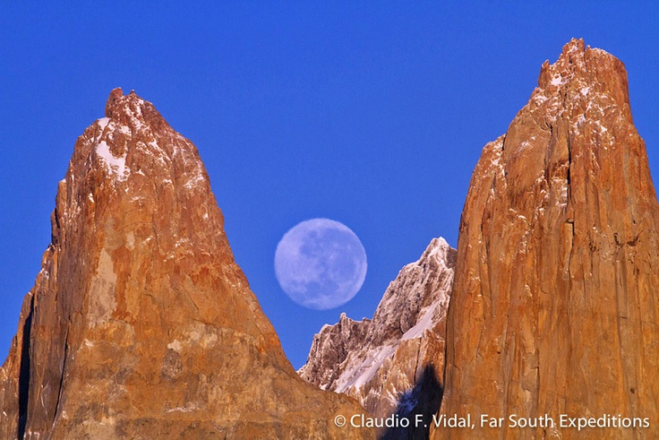 The Moon setting behind the awe-inspiring granite pinnacles of Patagonia's Torres del Paine, March 2013 © Claudio F. Vidal, Far South Expeditions